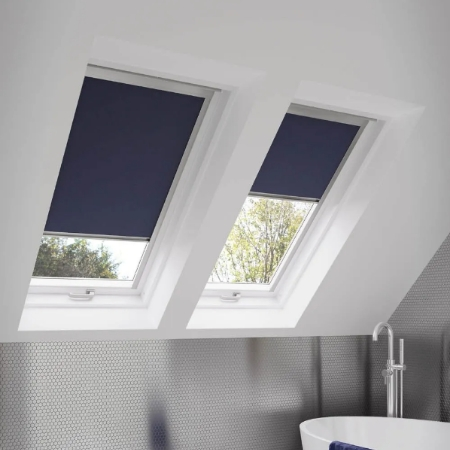 Dark blue perfect fit roller blinds on a skylight window