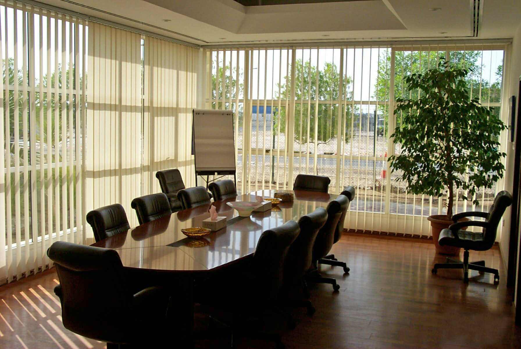 White vertical blinds in a wooden styled meeting room