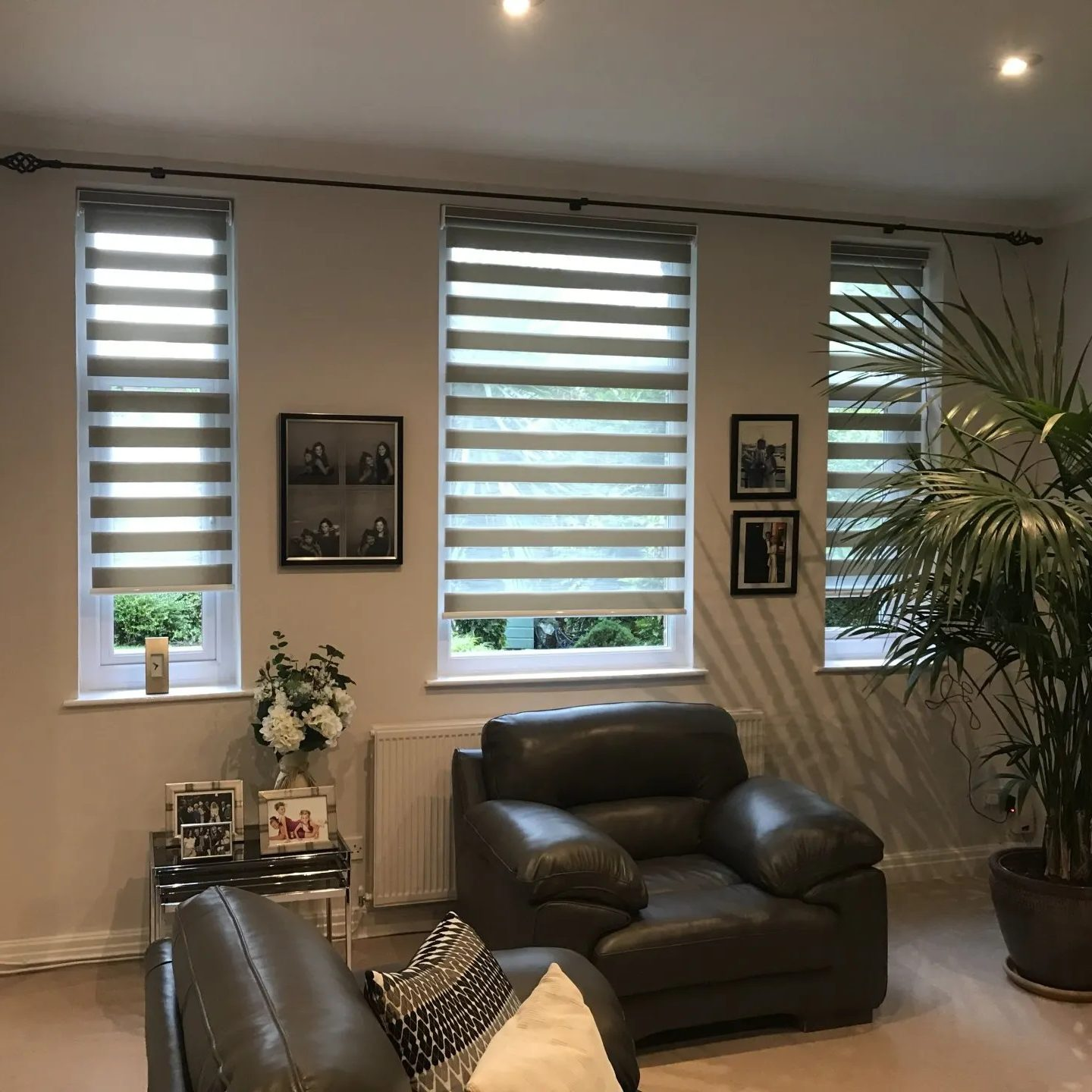 Grey striped roller blinds in white living room