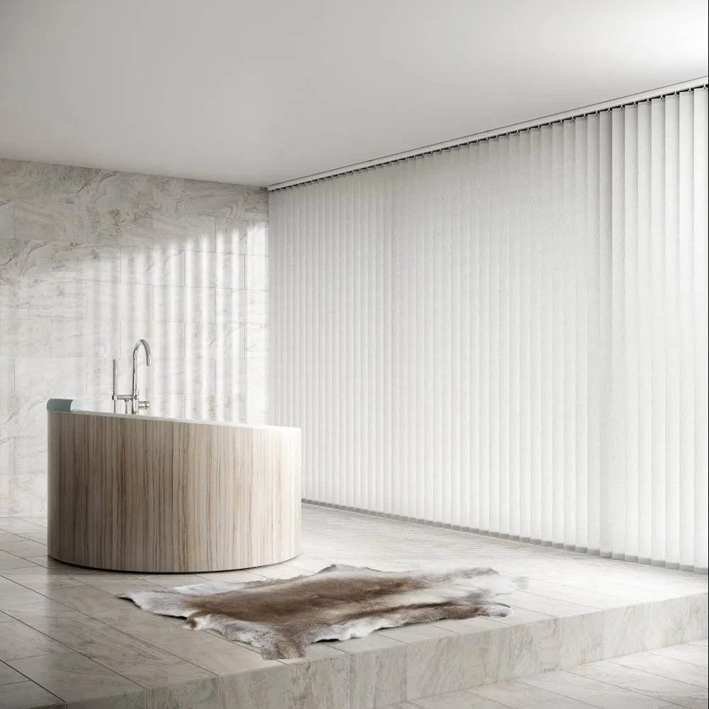 White vertical blinds in a marble bathroom