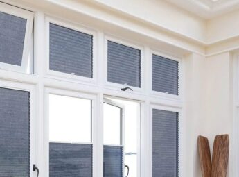 Blue perfect fit pleated blinds on white conservatory doors and windows