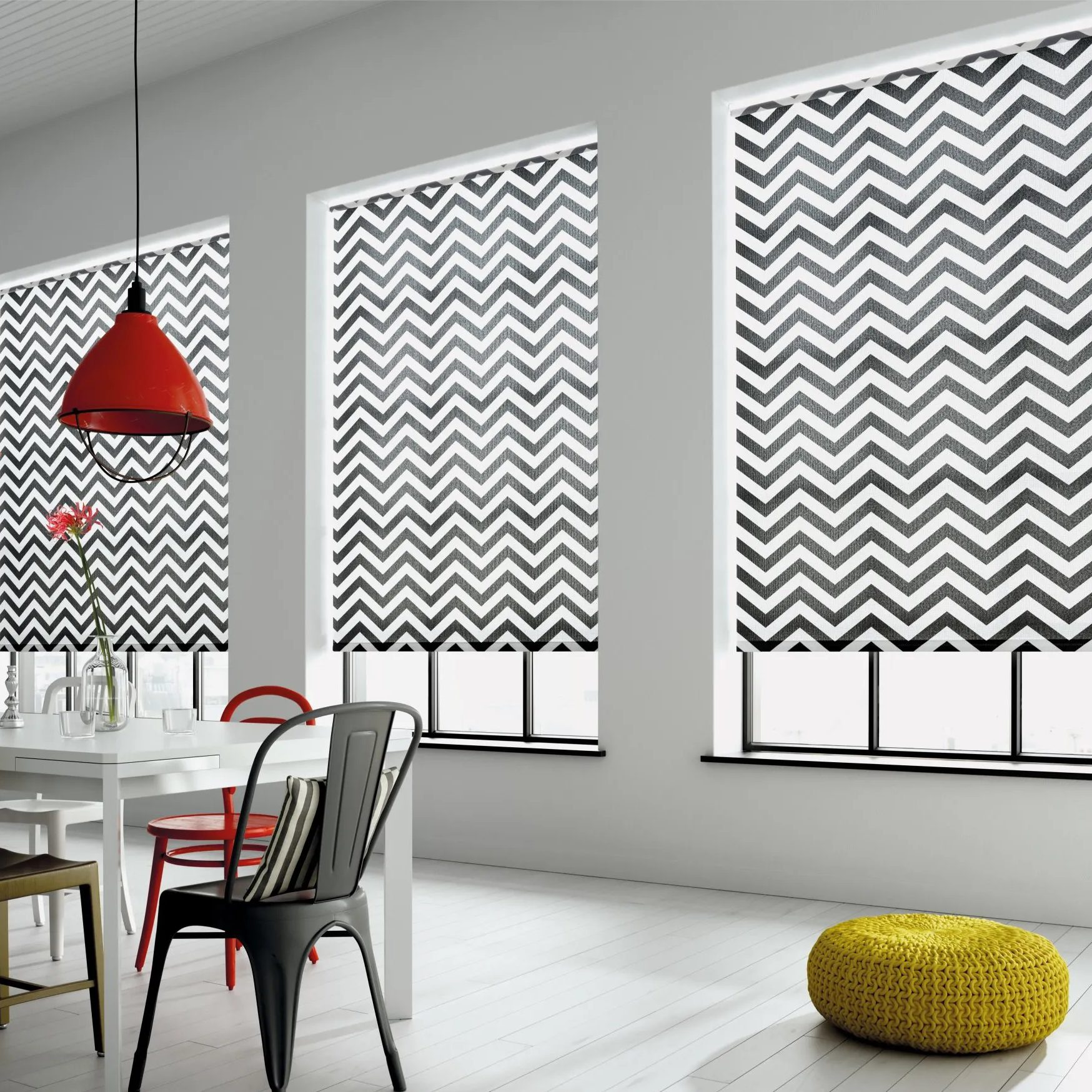 Black and white patterned roller blinds in a modern dining room