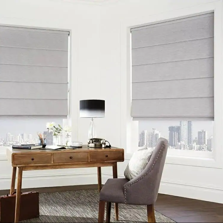 Grey roman blinds in a white home office
