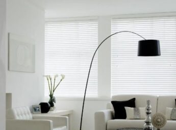 white venetian blinds in a black and white styled living room