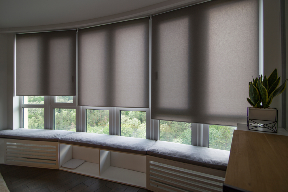 Installed motorised grey thermal blinds