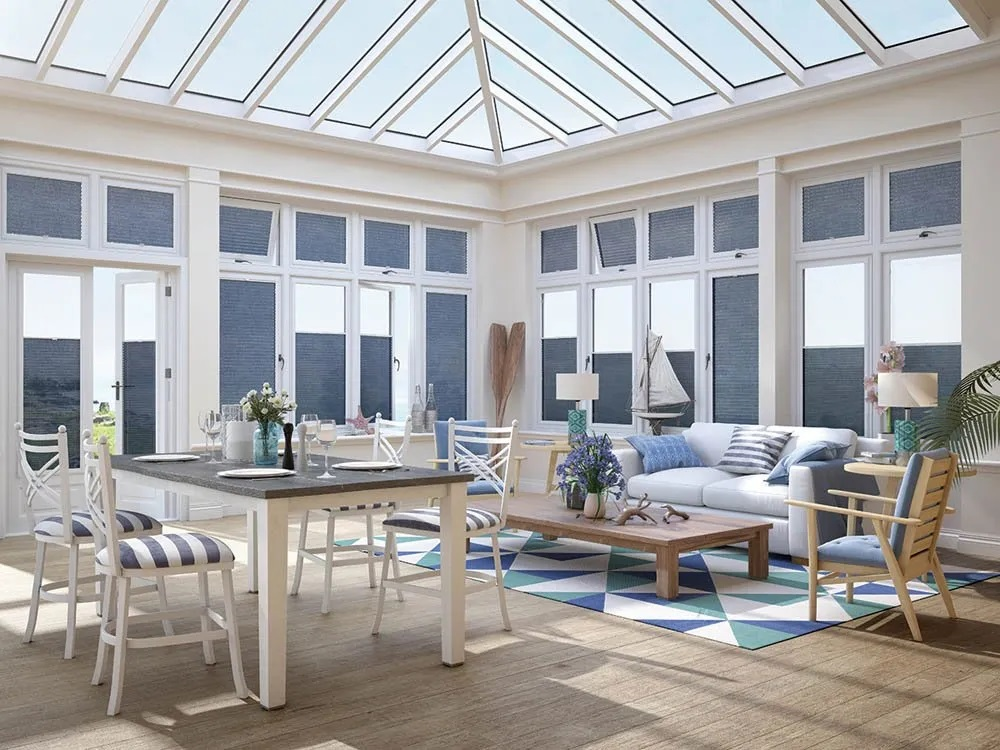 Blue made-to-measure pleated blinds in white conservatory
