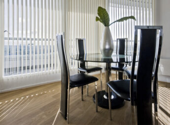 white vertical blinds in a modern dining room