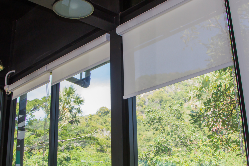 Set of white, perfect fit roller blinds