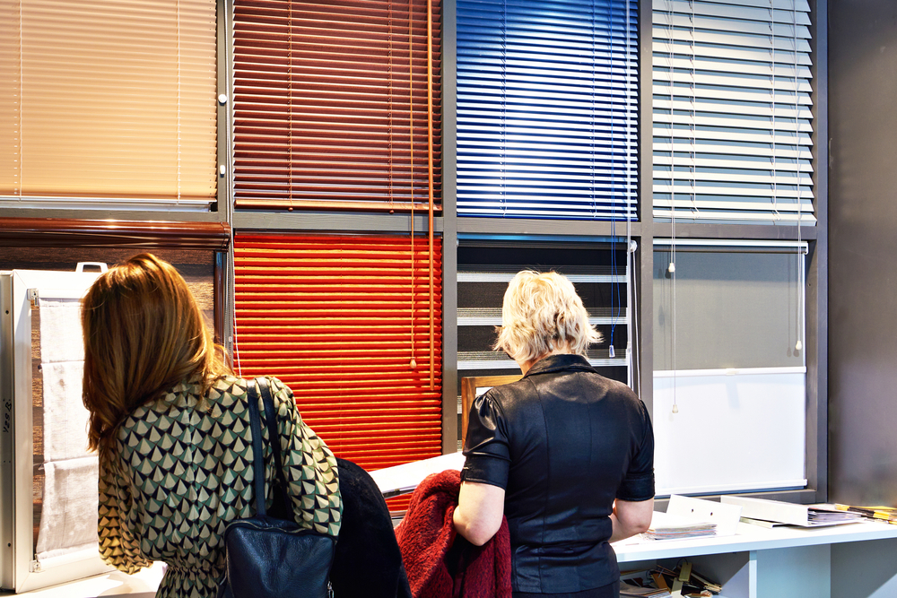 Two women shopping for different perfect fit blinds