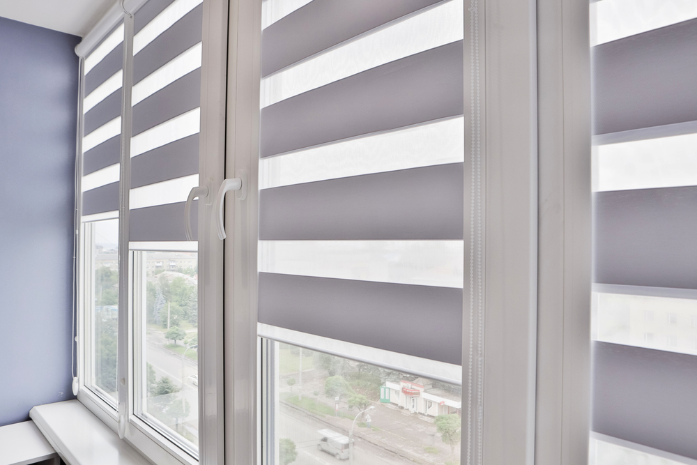 A pair of dimout concertina blinds