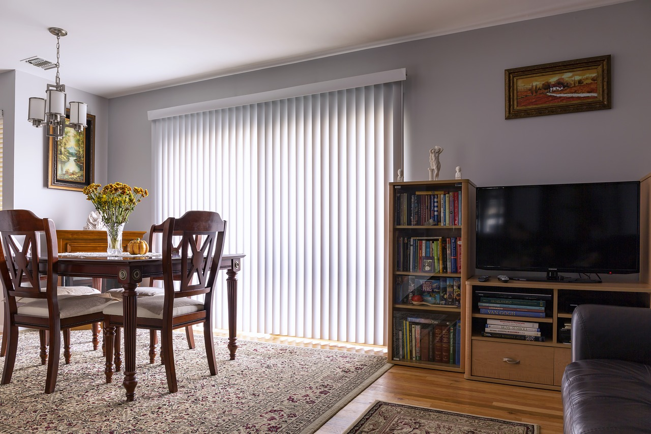 A set of blinds attached to sliding doors.