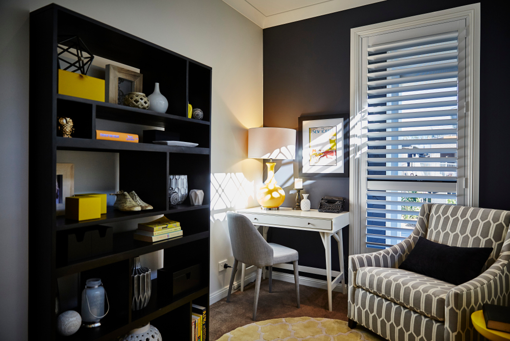 A set of plantation shutters in an office space.