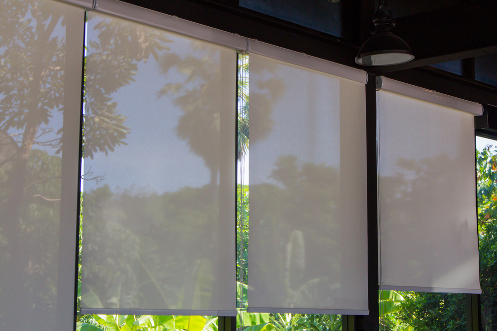 A pair of thermal fabric blinds used to keep the warmth inside.